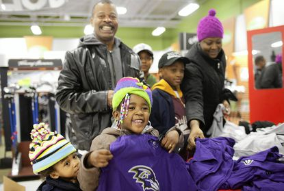 Soon after the Super Bowl was over and the Ravens were NFL champions, Baltimore residents, from left, Ahmia Rawlings, 2, Ahmaya Stratton, 5, Terry Rawlings, Ahmad Wilson, 9, Zion Stevenson, 7, and Stacy Rawlings were in the Sports Authority store on Baltimore National Pike in Catonsville to buy the newest Ravens t-shirts and hats. The store released merchandise touting the Ravens' Super Bowl win immediately after the game ended.