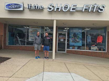 Charm City Run is acquiring the Frederick running store If the Shoe Fits. Pictured are owner John Kippen, who is retiring, and John Leonardis, who will remain as general manager.