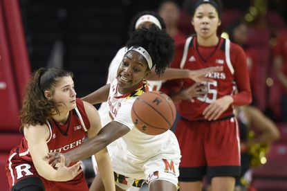 Marylands' Kaila Charles, right, defends as Rutgers' Noga Peleg Pelc passes in the second half of a NCAA basketball game last December in Baltimore.