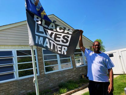 Chris Perkins first raised the Black Lives Matter flag at his Harford County home after white supremacists marched on Charlottesville, Va. in 2017.