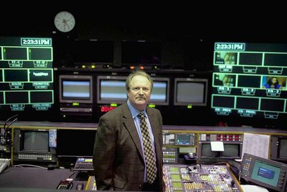 """Mike English, the executive producer for """"Outdoor Maryland,"""" stands in the control room at Maryland Public Television in Owings Mills."""