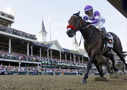Mario Gutierrez rides Nyquist to victory during the 142nd running of the Kentucky Derby horse race.