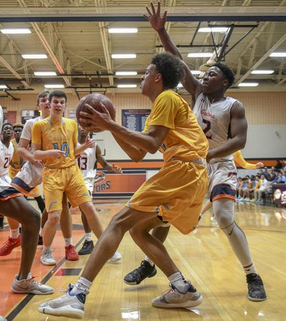 River Hill's Nick Marshall, center, and Reservoir's Jaylen Manning, right, helped guide their respective teams to a top half finish in the county standings last winter — one of six county schools with double-digit victories in league play.
