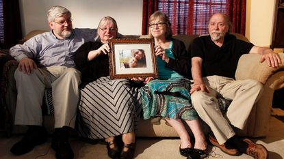 In this June 4, 2014, file photo, from left, Patrick Boyle, Linda Boyle, Lyn Coleman and Jim Coleman hold photo of their kidnapped children, Joshua Boyle and Caitlan Coleman, who were kidnapped by the Taliban in late 2012.
