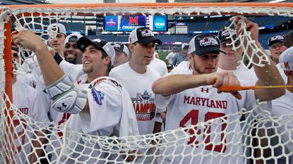 Maryland men's players cut down the net to celebrate after their 9-6 victory over Ohio State in the NCAA lacrosse championship game May 29, 2017, in Foxborough, Mass. The Terps hadn't won the national title since 1975, going 0-9 in the final during their drought.