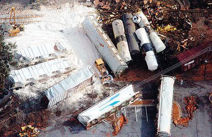 Overturned Norfolk Southern rail cars, above, are strewn along the ground in Graniteville, S.C., in January 2005. Nine people died and more than 250 were sickened after a freight train carrying toxic chlorine crashed into a parked locomotive. Human error caused the accident.