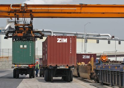 BALTIMORE, MD.--5/1/08-- Cargo containers are pictured being off-loaded from rail cars at CSX's intermodal facility at Seagirt Marine Terminal. Currently containers cannot be double-stacked on freight trains because of the height limit in the Howard Street Tunnel. BALTIMORE SUN STAFF PHOTO BY KENNETH K. LAM DSC_6724.JPG