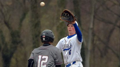 Loyola Dons first baseman Danny Sheeler rises to catch a throw to record the out on Archbishop Curley Friars batter Alvin Carela Fri., April 5, 2019.