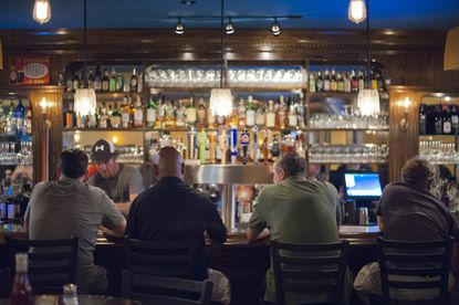 Patrons sit at the bar at In Like Flynn Tavern in Locust Point on a recent Saturday evening.