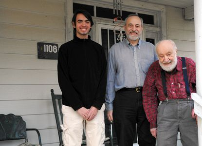 Three generations of Tamburrino men, including, from left, Dante, his father William and grandfather Bill, have built a model of Bill Tamburrino's home in Fallston. The trio stands on the porch of the real thing recently.