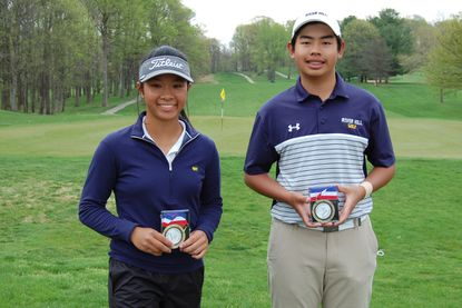 River Hill freshmen Helen Yeung, left, and Benjamin Siriboury pose with their championship medals after winning the Howard County Championship titles at Hobbit's Glen on April 12, 2021.