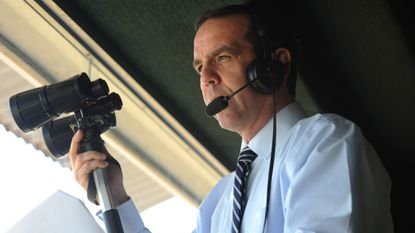 Announcer Dave Rodman calls an afternoon race at Pimlico Race Course in May 2014. The track at Timonium is so small that he hardly needs his binoculars.