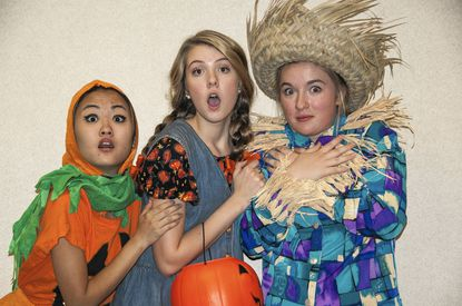 Emily Godfrey, Julia Kabernagel and Madelyn Brainard are ready to find Harriet a Halloween costume.