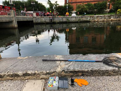 Tim Wolf left his fishing gear behind to help keep a man from drowning in the Jones Falls near the Eastern Avenue bridge in Baltimore Sunday morning.