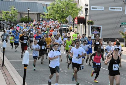 Harford County is ranked fourth among Maryland counties for health outcomes in a national study released this week, as obesity and smoking rates, among other factors, show improvement. Above, more than a thousand runners took to the streets of Bel Air last June for the annual Town Run.