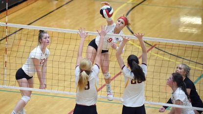 Glenelg's Maddie Myers tries for a kill past Hereford teammates Cindy Parker, left, and Shelby Jones during a Class 2A state semifinal volleyball match at University of Maryland's Ritchie Coliseum on Tuesday, Nov. 13.
