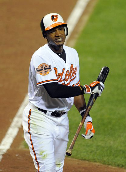 Orioles center fielder Adam Jones strikes out with two runners on base in the bottom of the ninth inning at Camden Yards. Jones hit his 23rd home run of the season earlier in the game, but the Orioles lost, 3-1, to the Tampa Bay Rays.