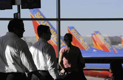Travelers begin boarding a Southwest Airlines flight at BWI-Thurgood Marshall Airport. The airport's largest carrier will be the subject of an upcoming TLC reality show.