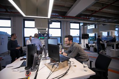 <p>Employees stand at desks at a Robert Bosch office in Berlin on Jan. 18, 2018. A new study suggests standing for too long at a desk may have negative health and productivity effects.</p>
