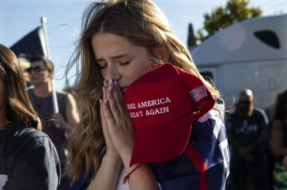 Liza Durasenko, 16, from Oregon City, Oregon, prays during a rally in support of President Donald Trump, Aug. 29, in Clackamas, Oregon.