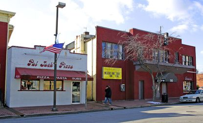 This 2007 photo depicts the Joke's on Us Comedy Club in Laurel (right). The club has sat vacant for years and was purchased by Laurel city last week.