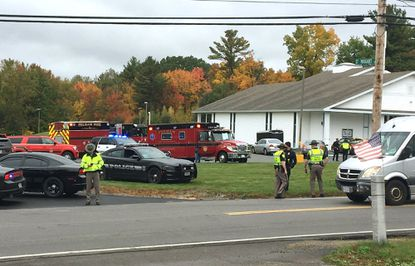 In this image from video, police stand outside the New England Pentecostal Church after reports of a shooting on on Oct. 12, 2019, in Pelham, N.H.