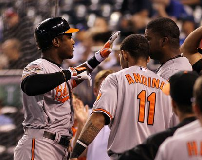 Adam Jones gets congratulated by his Orioles teammates after hitting what would be the game-winning solo homer against the Royals in the 15th inning.