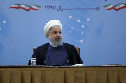 President Hassan Rouhani attends a meeting with a group of foreign ministry officials in Tehran, Iran, July 22. He warned President Donald Trump against provoking his country while indicating peace between the two nations might still be possible.