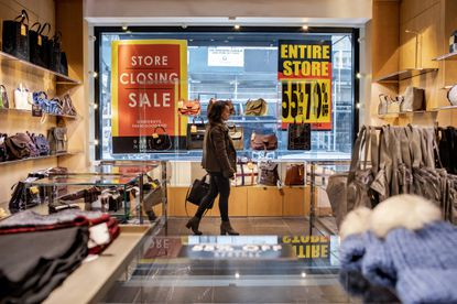 Sale signs on the windows of Barneys in New York, Jan. 16, 2020. As the retailer goes through liquidation, employees at its flagship store say they haven't received information about a closing date, severance pay or benefits. (Stephen Speranza/The New York Times)
