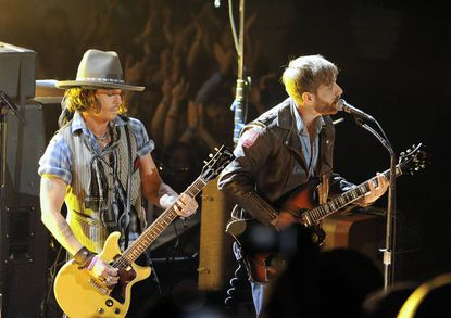 Musicians Johnny Depp (L) and Dan Auerbach of The Black Keys perform onstage during the 2012 MTV Movie Awards held at Gibson Amphitheatre in Universal City, California.