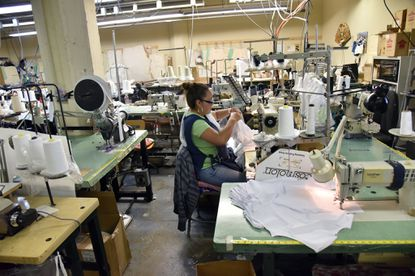 Baltimore, Md--9/2/15--Mariana Caltempa, sewing machine operator, works on a transgender top at Fashions Unlimited, a nearly 40-year-old contract apparel manufacturer started and based in Baltimore.