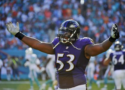 Ravens center Jeremy Zuttah celebrates after a touchdown against the Miami Dolphins during the second half at Sun Life Stadium. Ravens won 28-13.