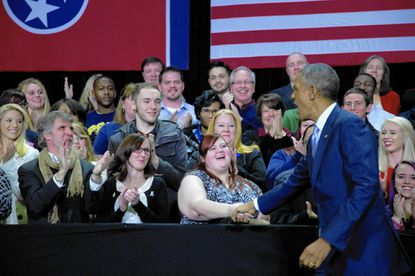 President Barack Obama greets people on stage as he arrive to speaks at Pellissippi State Community College, Friday, Jan. 9, 2015, in Knoxville, Tenn., about new initiatives to help more Americans go to college and get the skills they need to succeed.
