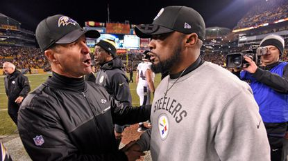 Steelers coach Mike Tomlin, right, and Ravens coach John Harbaugh meet following the Steelers' 31-27 win on Christmas Day last year. The two teams meet on Sunday.
