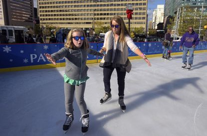 Skaters at the opening of the Pandora Ice Rink in the Inner Harbor.