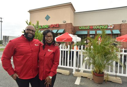 Jazz and Sandy Taylor, owners of Island Spice Grille and Lounge. Jazz Taylor, the chef, is from Jamaica and Sandy, his wife, is from Guyana.
