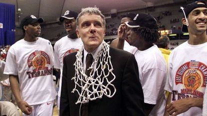 Maryland coach Gary Williams, center, and players, Chris Wilcox, left, Tahj Holden, Calvin McCall and Drew Nicholas, right, gather following the 90-82 win over Connecticut during their NCAA East Regional finals game in Syracuse, N.Y., Sunday, March 24, 2002.
