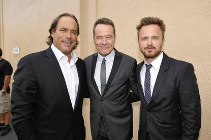 "Steve Mosko, left, a 1974 John Carroll School graduate, poses with Bryan Cranston and Aaron Paul from the hit series ""Breaking Bad."""