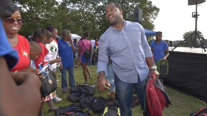 City Councilman Nick Mosby and his office staff and volunteers passed out 500 book bags at Easterwood Park.