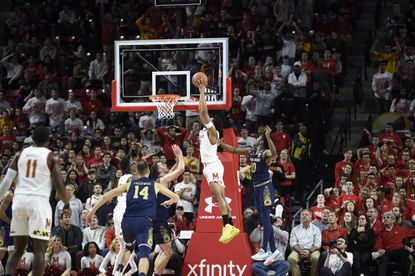 Maryland sophomore Aaron Wiggins follows his own 3-point miss for a dunk against Notre Dame on Wednesday at Xfinity Center in College Park.