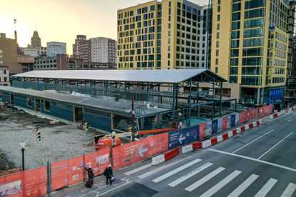 With steel framing in place, work progresses on the new South Market building at Lexington Market on Paca Street.