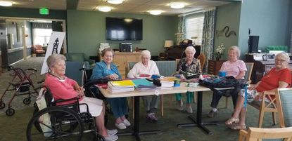 """The """"Over the Hill Gang"""" at the Lorien Taneytown assisted living facility stay active with a variety of activities, including putting together backpacks stuffed with supplies for local students in need. - Original Credit:"""