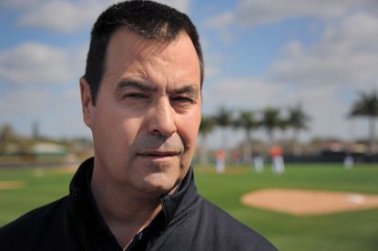 Dan Duquette, executive vice president of the Orioles, talks to the media during spring training practice at the Ed Smith Stadium complex in February.