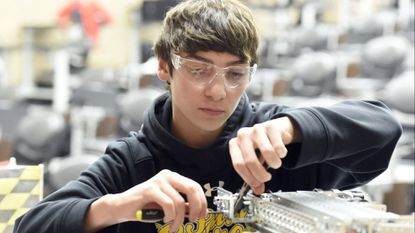 South Carroll student Andrew Melis makes adjustments to his team's robot in February 2018. Technology infrastructure, lifelong learning, investing in facilities and growth in the county's Career and Technology Center are key priorities for the future of education in Carroll.