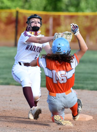 Havre de Grace infielder Carlie Hopps makes the grab on the throw before putting the tag on the Fallston baserunner during Monday's game at Havre de Grace.