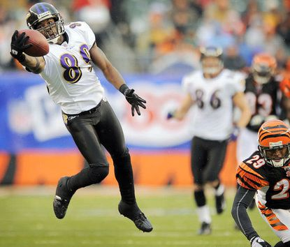 Ravens wide receiver Mark Clayton (left) beats the Bengals' Leon Hall to make a one-handed catch on a 70-yard touchdown in the third quarter.