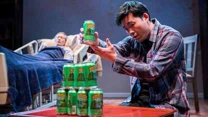 """Tony Nam as Ray, foreground, and Glenn Kubota as Father in Everyman Theatre's production of Julia Cho's """"Aubergine."""""""