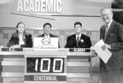 """Mac McGarry hosts as Centennial High School competes in an """"It's Academic"""" playoff in 1991. The Centennial team consisted of K.C. Frodyma (left), Captain Charles Lin and Albert Luo."""