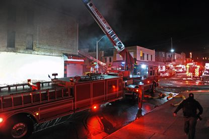 Baltimore firefighters battle one of many blazesset around the city on April 27, the day of Freddie Gray's funeral. On Thursday, officials announced that a 21-year-old man was charged in connection with one of the fires.