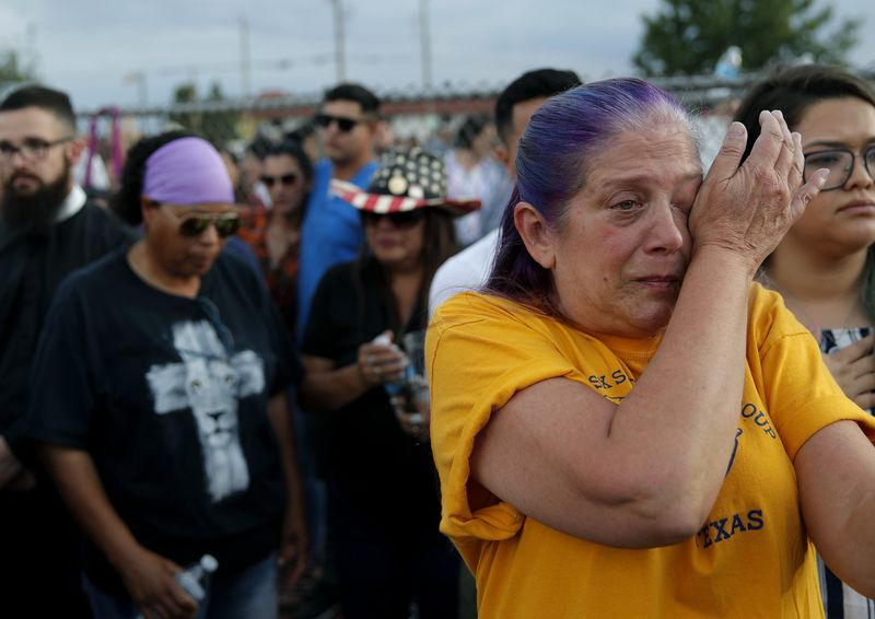 "Cathe Hill cries during a vigil for victims of Saturday's mass shooting in El Paso. ""There's no such thing as a stranger here in El Paso,"" Hill said of the effect the shooting had on the community."